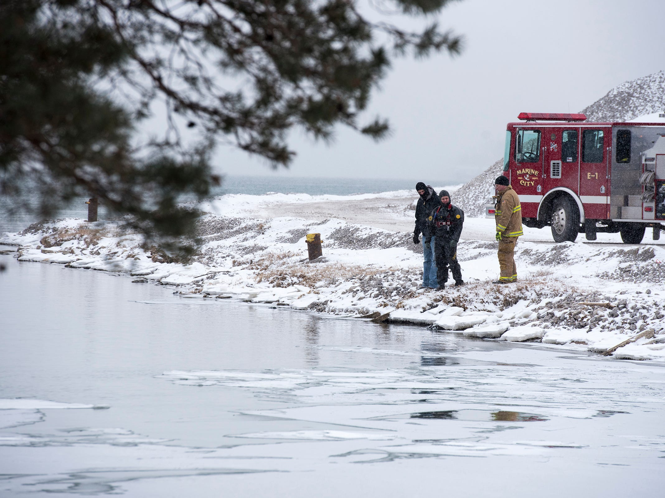 Crews investigate a scene where a vehicle went into the river Monday, March 4, 2019, where the Belle River meets the St. Clair River in Marine City. Police spotted tracks appearing to enter the waterway in the 1300 block of South Water Street shortly before 9:30 a.m. A body was discovered in the water.