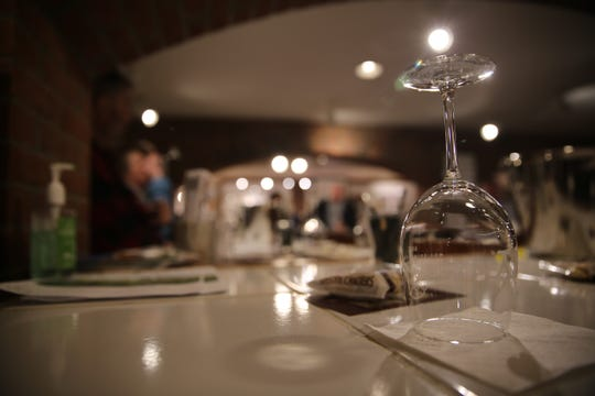 Patrons sit at a bar inside Millbrook Vineyards and Winery. David Bova, one of the winery's owners, said he doesn't think the entire stretch limousine industry should pay as a result of the Schoharie, New York, limo crash that killed 20 people.