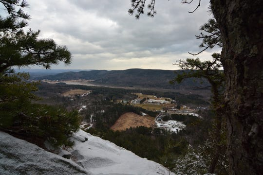 Take the time, but watch your step, to enjoy the view from Squaw Peak.