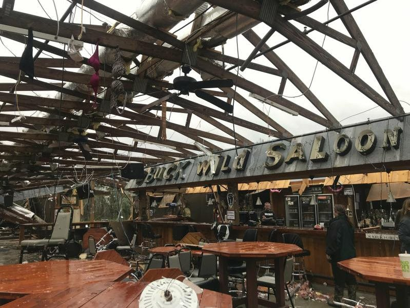 This photo shows some damage at the Buck Wild Saloon, located on U.S. Highway 280, east of Smiths Station, Ala., Sunday, March 3, 2019, after a powerful storm system passed through the area. (Kara Coleman Fields/Opelika-Auburn News via AP)