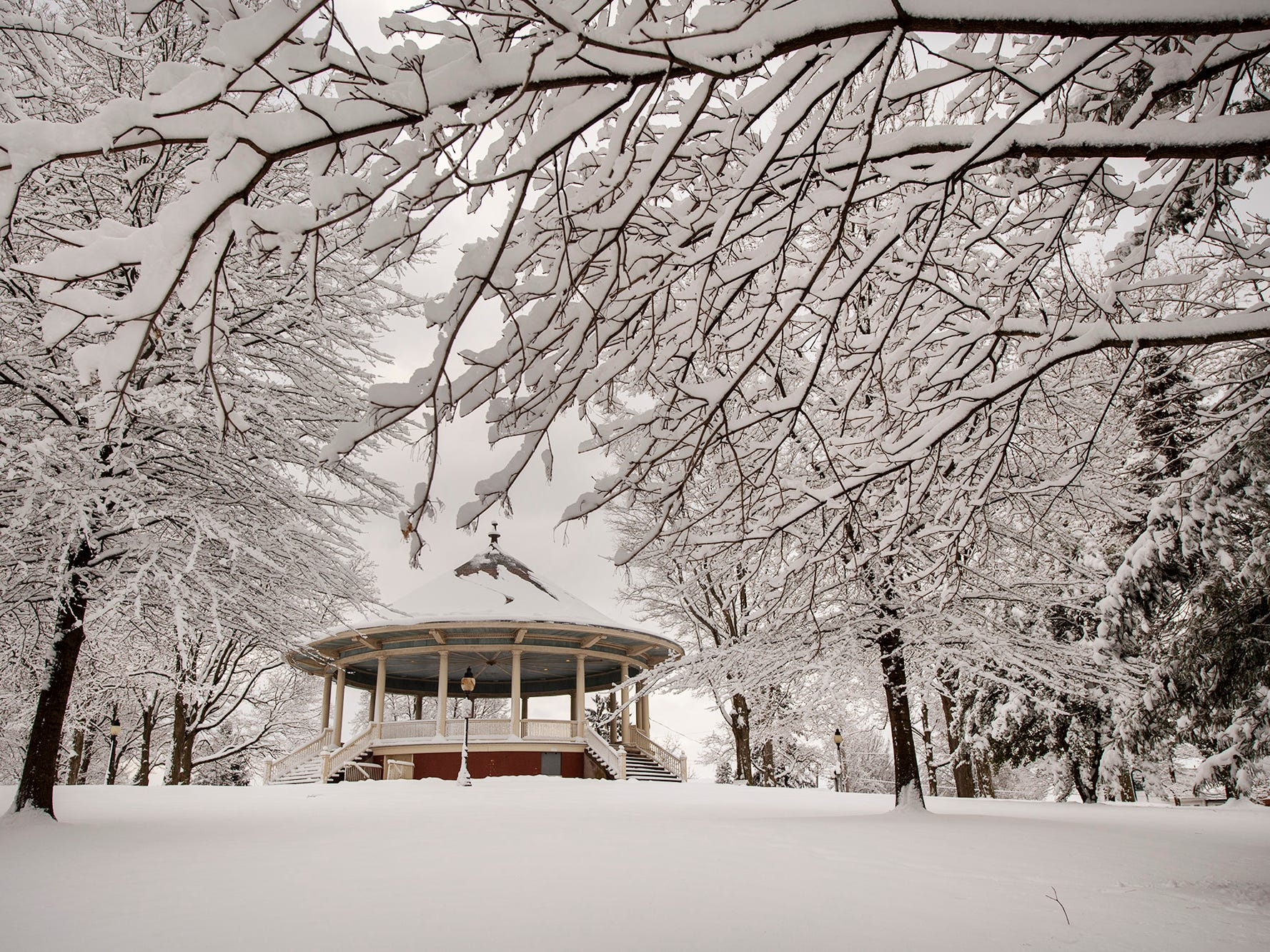 The bandstand shrouded by snowy trees in Farquahr Park Monday March 4, 2019.