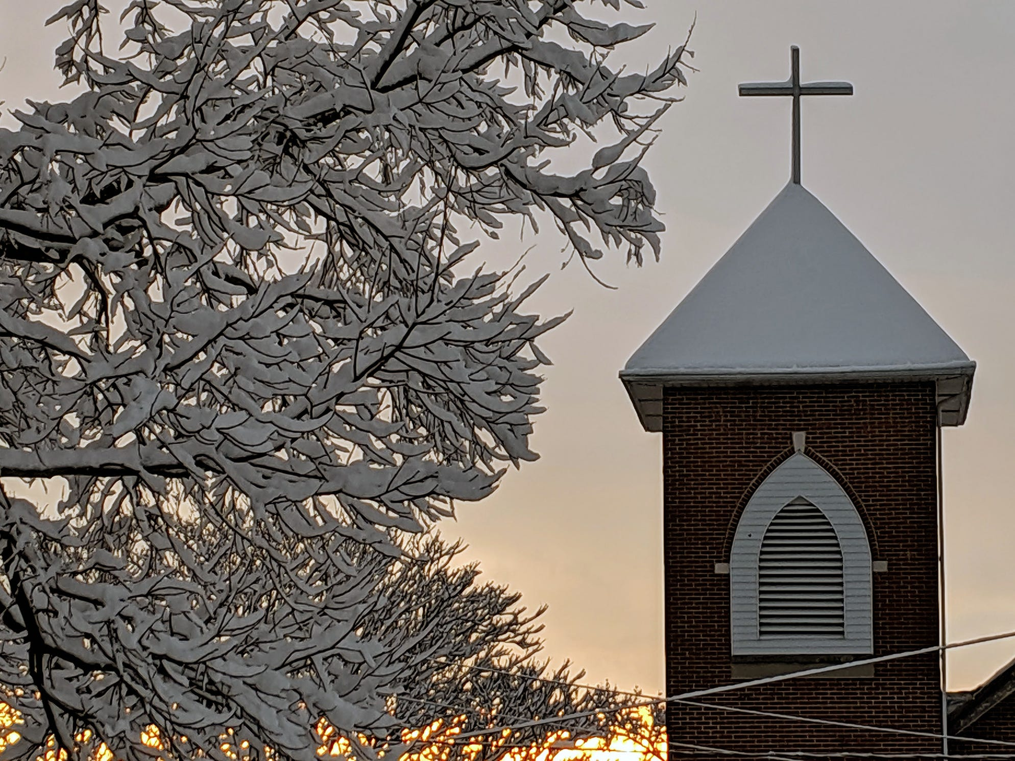 The sun rises on a snowy landscape in Manchester Township Monday after several inches of snow fell in York County.