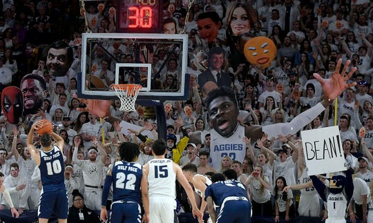 Utah State fans try to distract Nevada forward Caleb Martin as he shoots a free throw during Saturday's game.