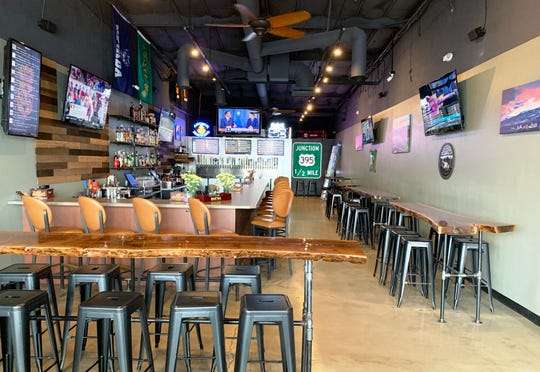 The 395 Craft Beer & Spirits features several large-screen televisions.