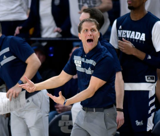 Nevada head coach Eric Musselman tries to get an official's attention during the Wolf Pack's loss at Utah State on Saturday.