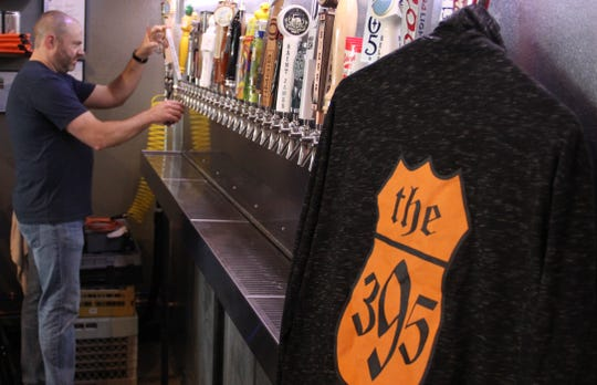 Bret Schaeffer, an owner of The 395 Craft Beer & Spirits, which offers more than 30 beers and ciders on tap.