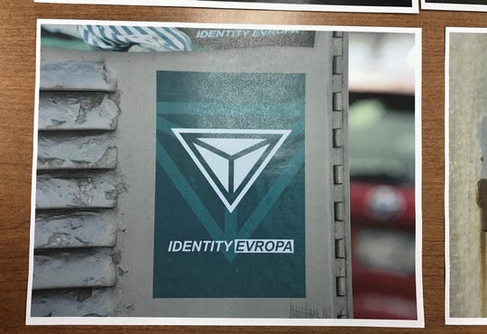 This photo from the Brighton Police Department shows one of several fliers found throughout the town depicting the name and logo of an American neo-Nazi group called Identity Evropa.