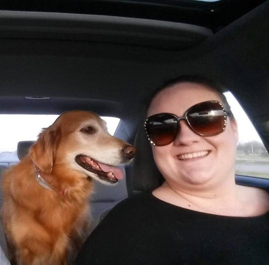 Jessica Lamb smiles during a car ride with her rescue dog, Sadie. Though Sadie died in 2016, Lamb donated a parcel of land to Irondequoit and the town is going to use it to create a pocket park called Sadie's Place.