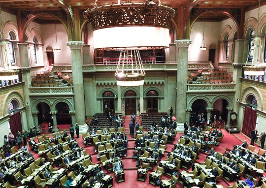 New York state Assembly members debate new legislation reforms to protect New Yorkers from gun violence in the Assembly Chamber at the state Capitol on Tuesday, Jan. 29, 2019, in Albany, N.Y.