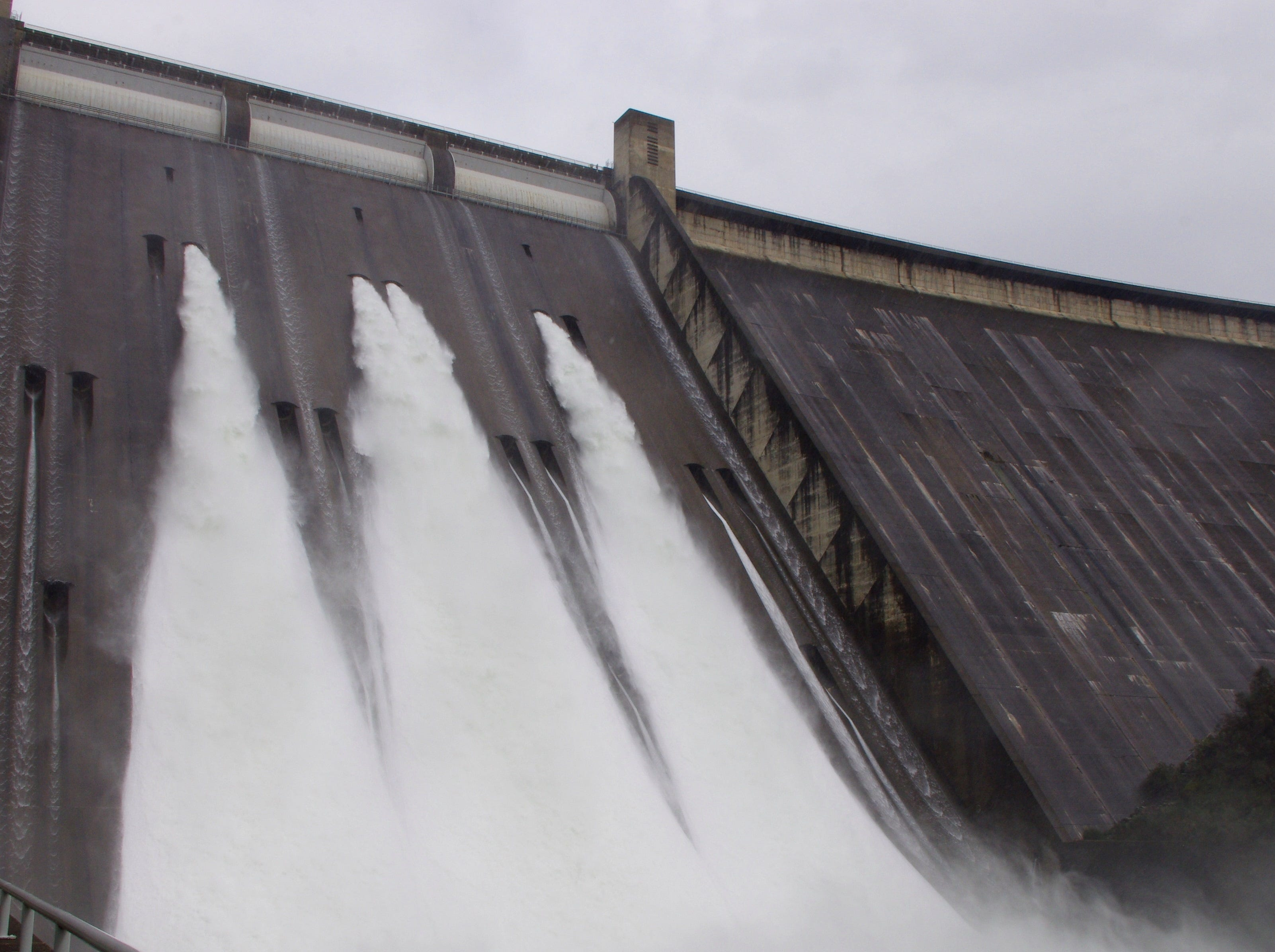 Ports on the Shasta Dam spillway send thousands of gallons of water down the face of the dam Monday. The amount of water released rose to 30,000 cubic-feet per second.