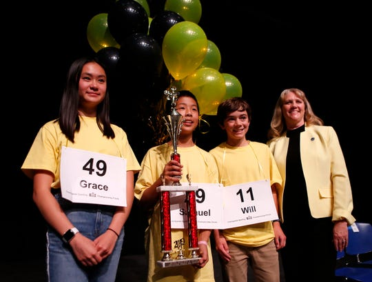 Carmel Middle School student Grace Wong, left, stands beside Washington Middle School eighth grader Samuel Low, Pacific Grove Middle School eighth grader William Coen and Monterey County Superintendent of Schools Deneen Guss at the end of the Monterey County Office of Education's 2019 Countywide Spelling Bee.