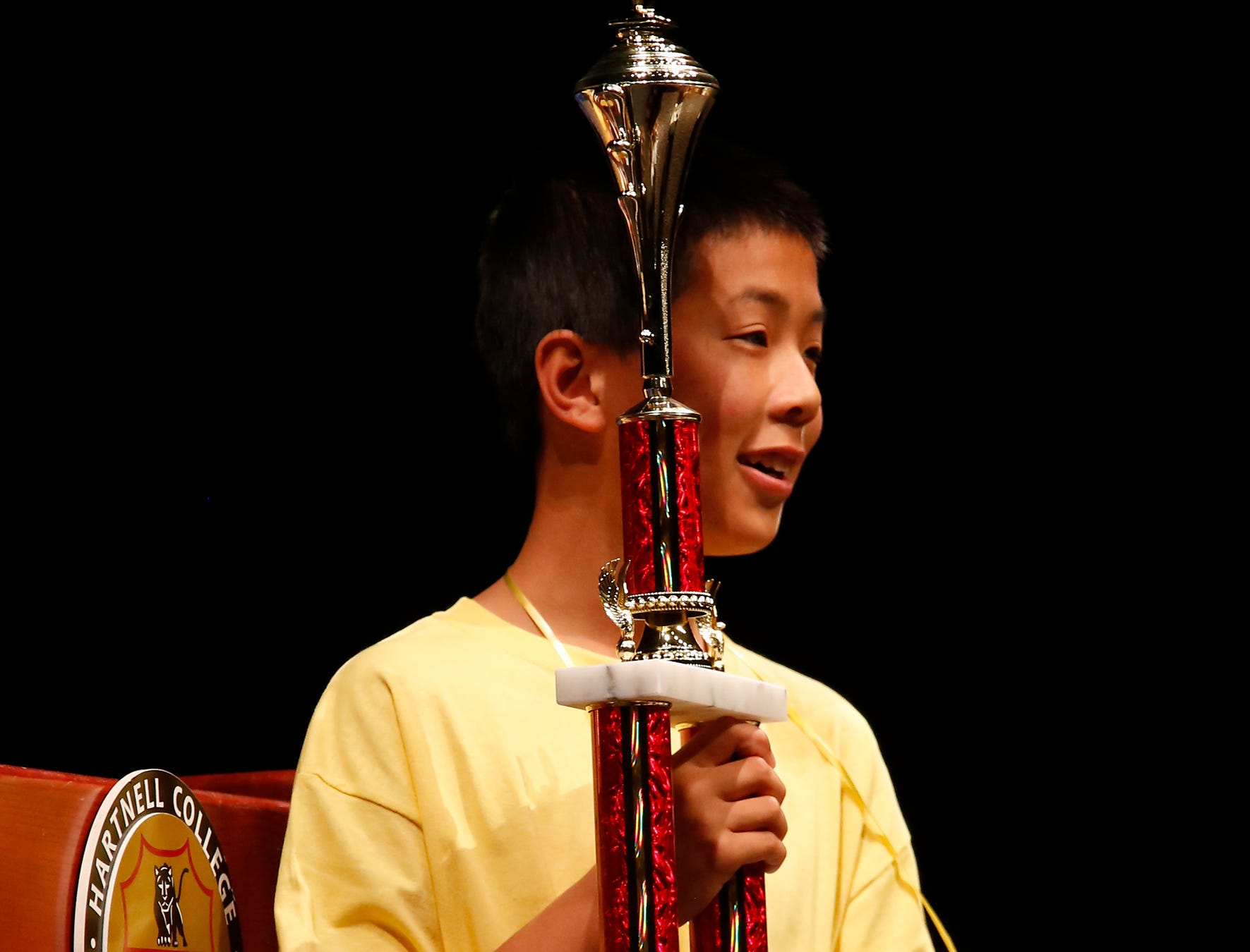 Washington Middle School eighth-grader Samuel Low holds the trophy after winning the Monterey County Office of Education's Countywide Spelling Bee Championship Finals.