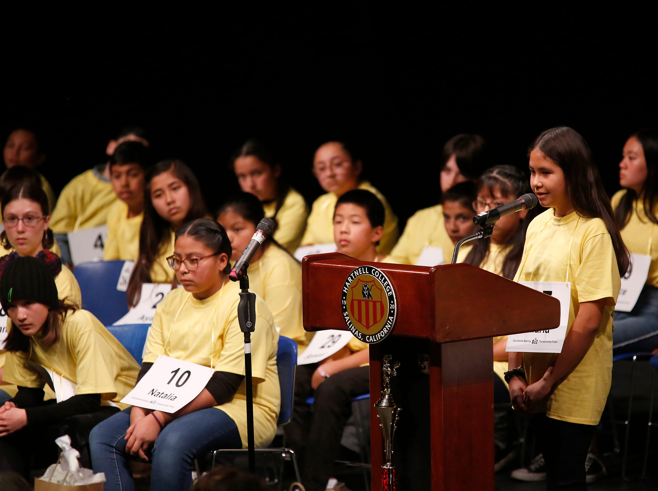 Loma Vista Elementary sixth-grader Maria Pantoja Garcia spells out a word during the Monterey County Office of Education's 2019 Countywide Spelling Bee.