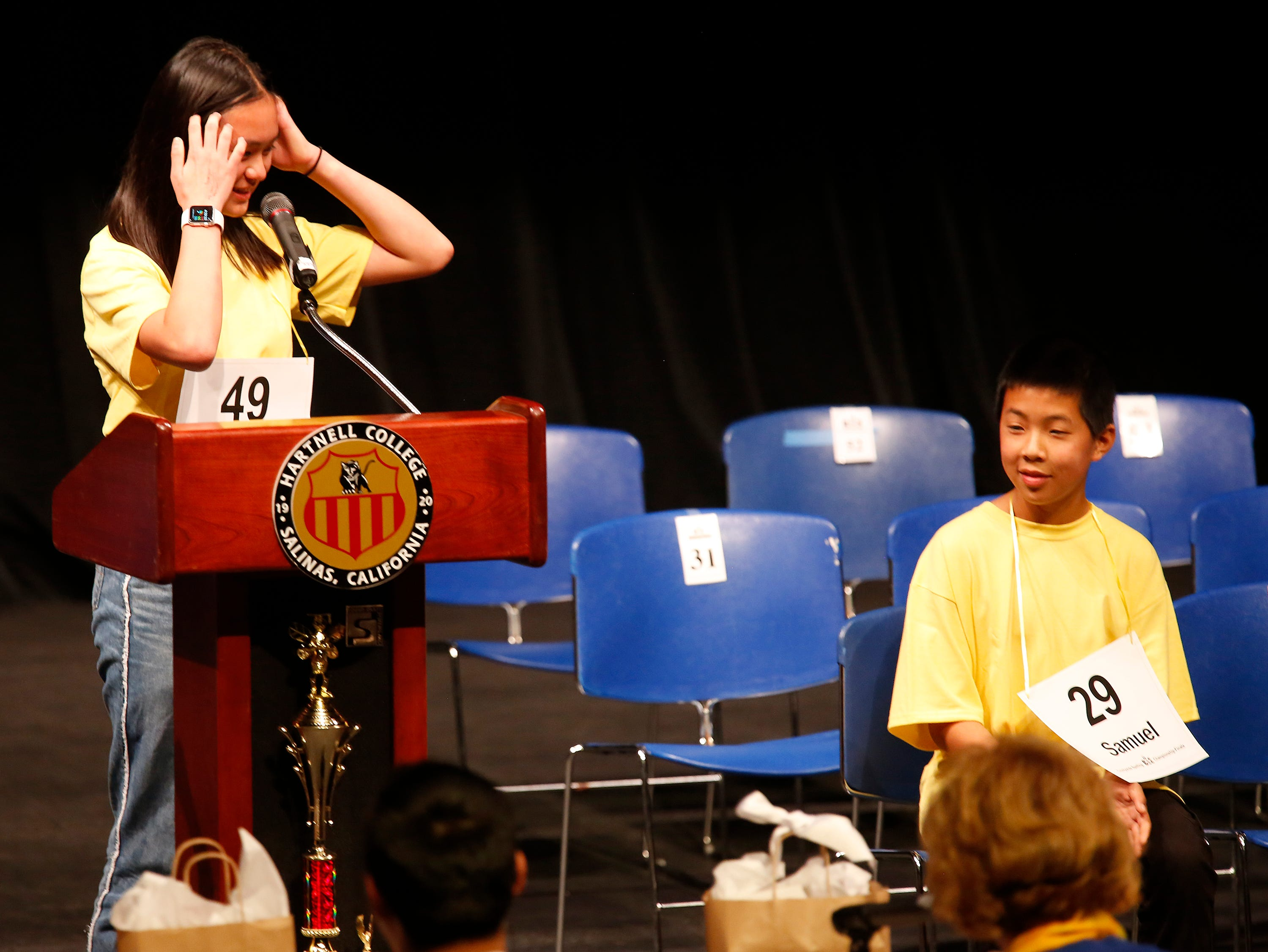 Carmel Middle School eighth grade student Grace Wong reacts after spelling her final word incorrectly as Washington Middle School eighth-grader Samuel Low looks on during the Monterey County Office of Education's 2019 Countywide Spelling Bee.