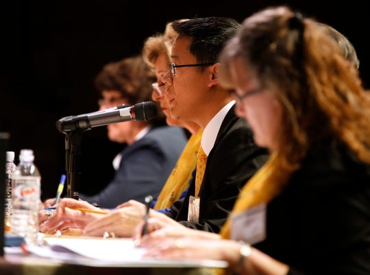 Pronouncer Henry Cho Jr. asks a contestant to spell a word during the Monterey County Office of Education's Countywide Spelling Bee.