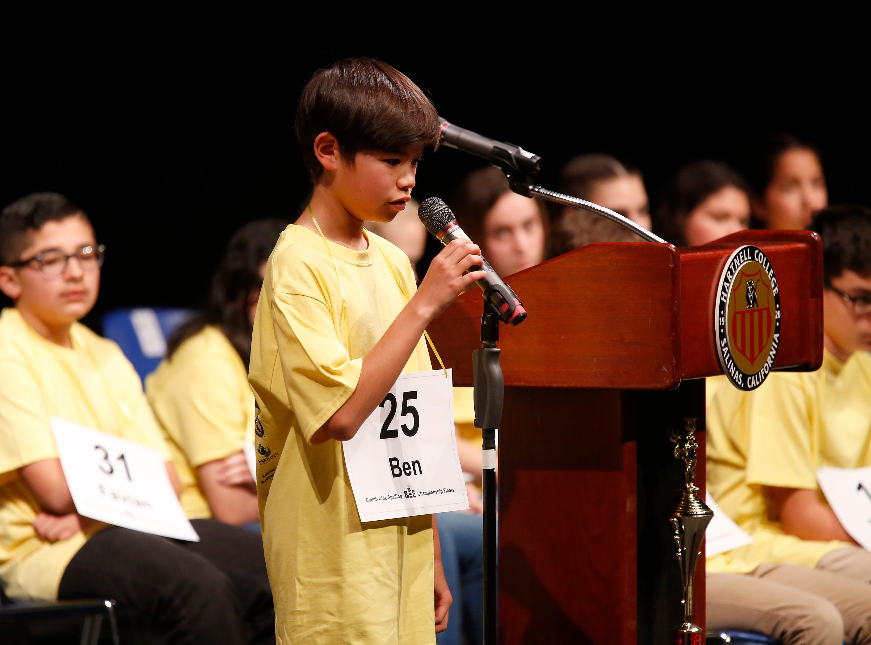 Lincoln Elementary School sixth-grader Ben Douglas Knapp spells out a word during the Monterey County Office of Education's 2019 Countywide Spelling Bee.