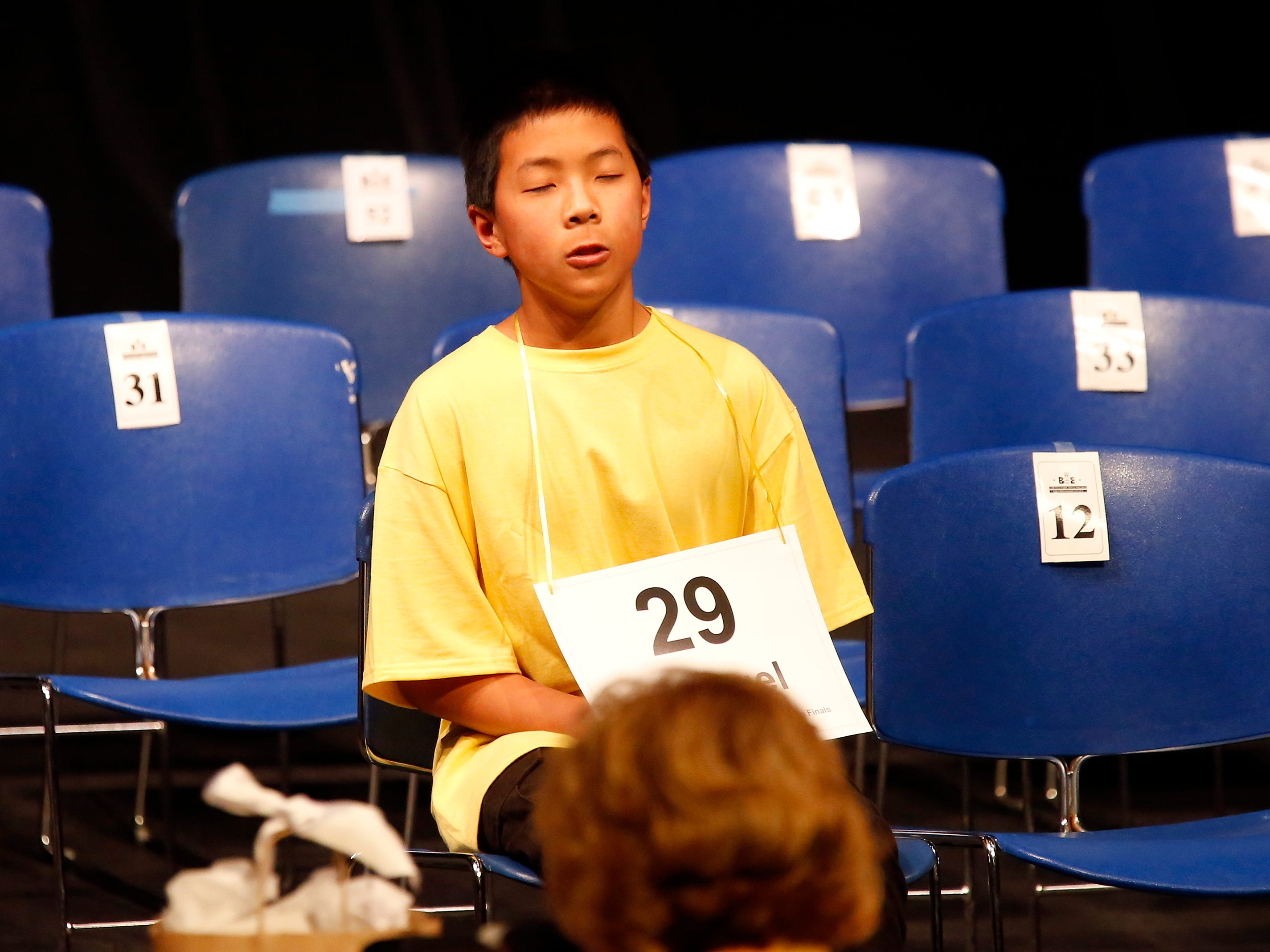 Washington Middle School eighth-grader Samuel Low exhales after spelling a word correctly to advance during the Monterey County Office of Education's 2019 Countywide Spelling Bee at Hartnell College in Salinas.