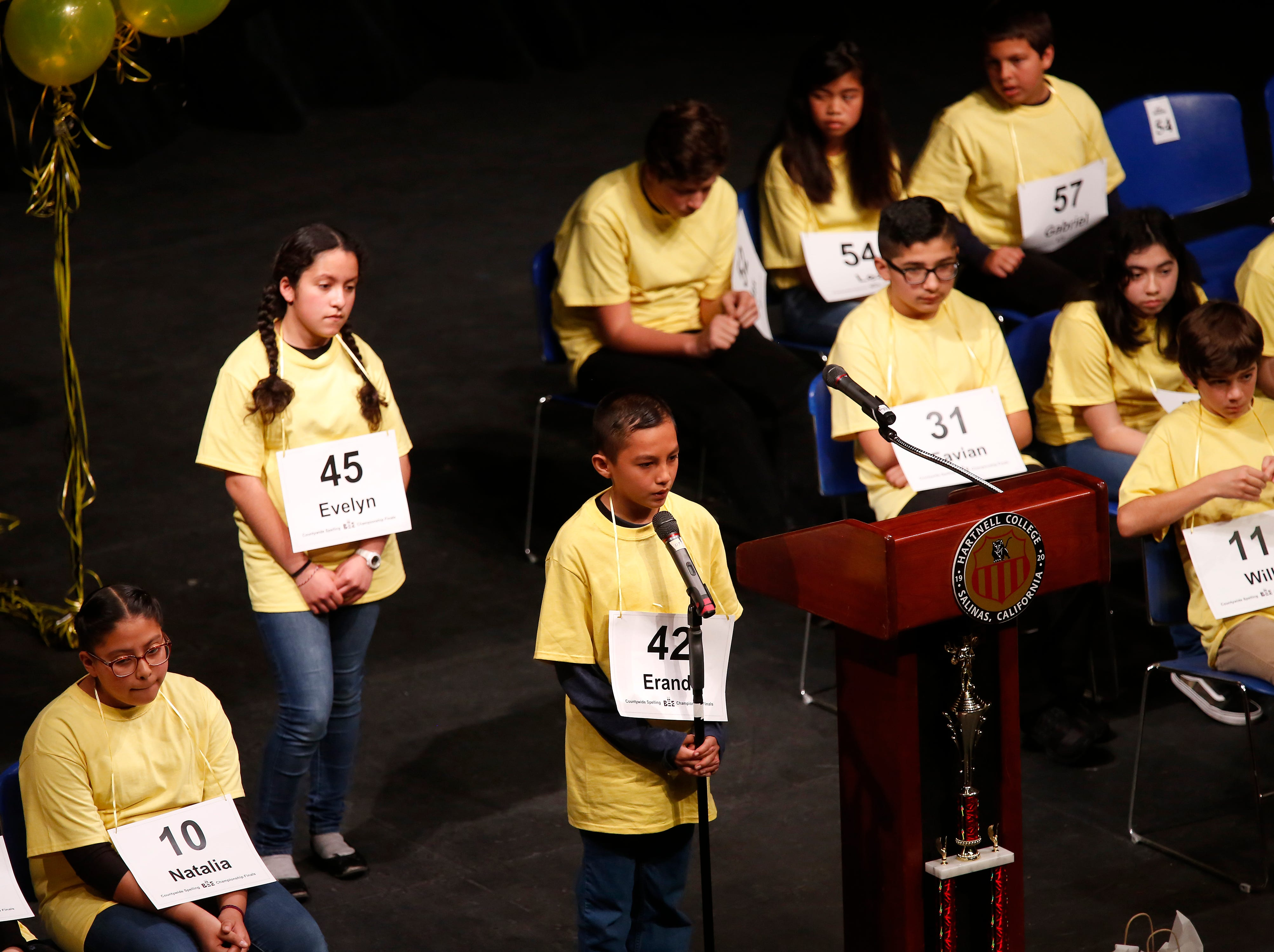 Sherwood Elementary School sixth-grader Erandi Robles spells out a word during the Monterey County Office of Education's 2019 Countywide Spelling Bee.