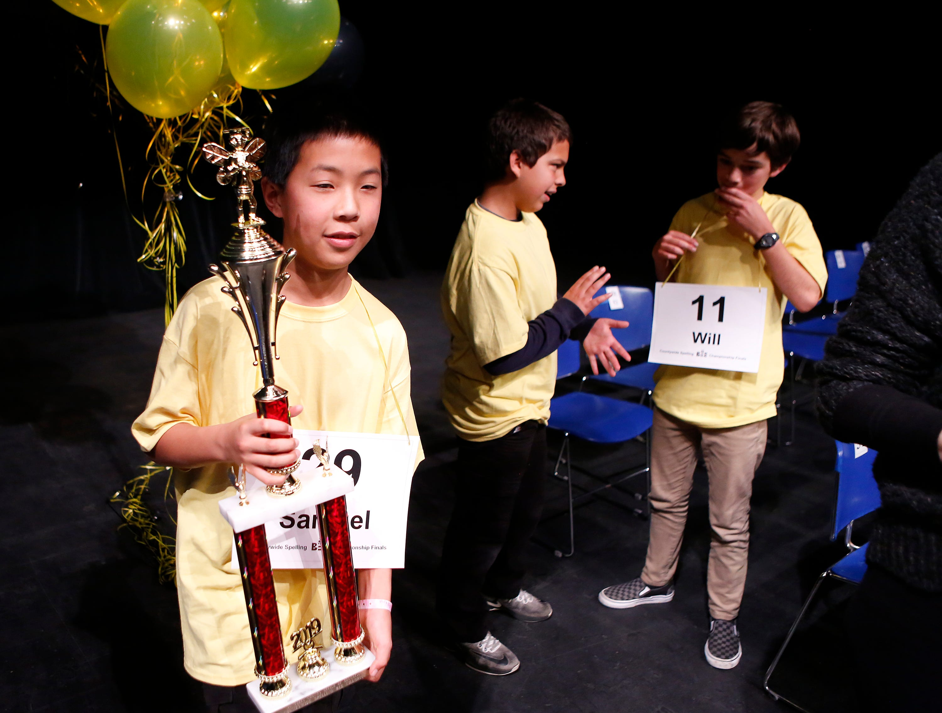 Washington Middle School eighth-grader Samuel Low walks off with the winners trophy at the end of the Monterey County Office of Education's 2019 Countywide Spelling Bee.