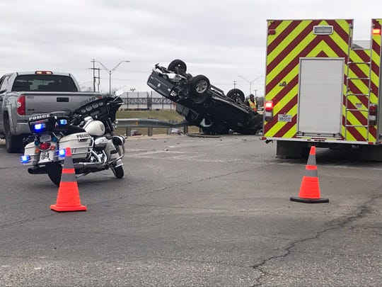A pickup rolls over a guard rail at the intersection of Shiloh and Jefferson Monday, March 3, 2019.