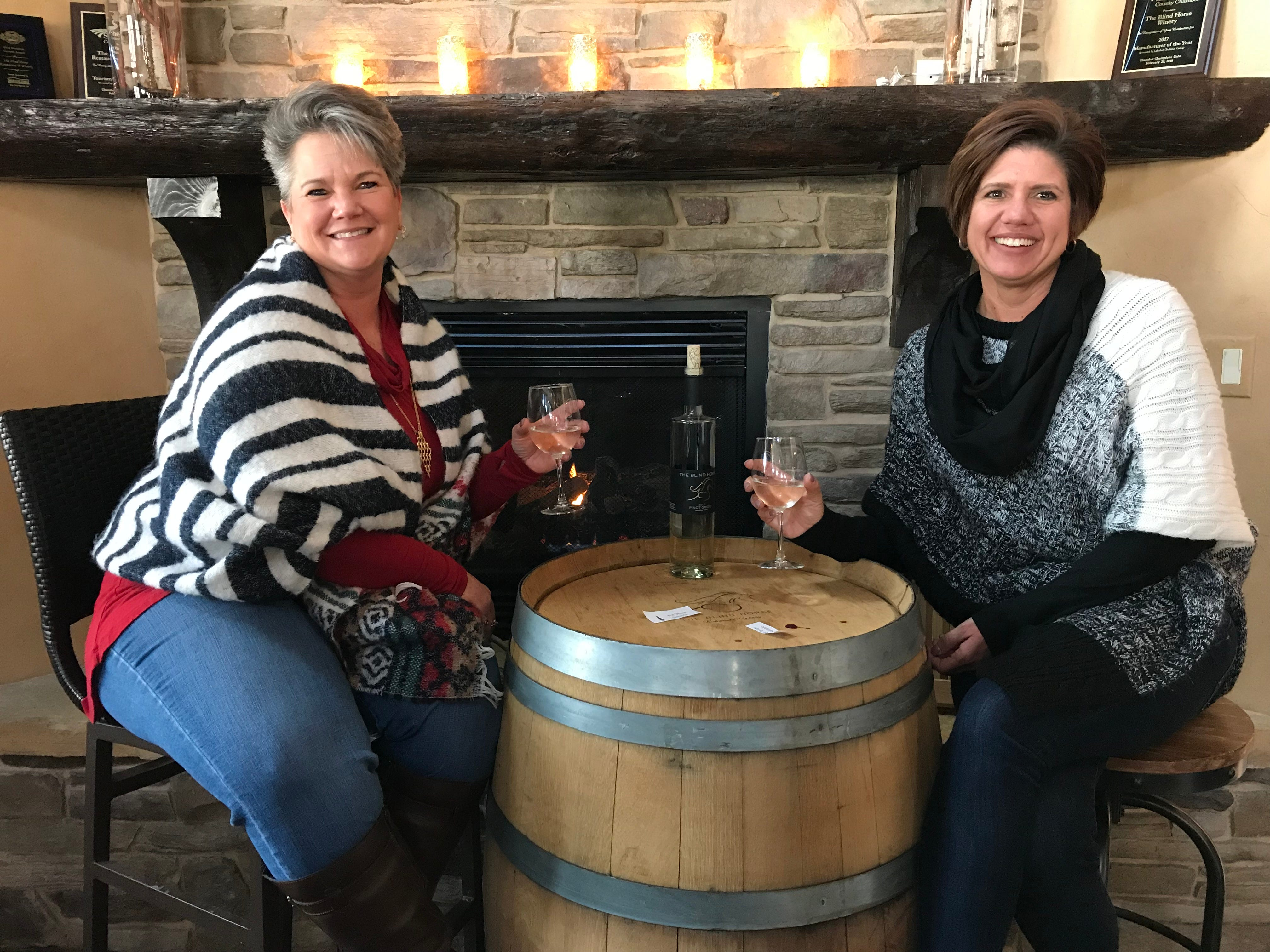 Maria Myers and Heidi Soodsma enjoying wine during the second launch party for ice wine at the Blind Horse. Both ladies love the atmosphere of the Blind Horse, the live music and the friendliness of the staff.
