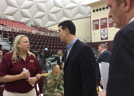 BPCC women's coach Brenda Welch-Nichols visits with BPCC men's coach Chris Lovell, while Cavalier athletic director John Rennie looks on Monday in the Centenary Gold Dome in preparation for the 2019 NJCAA Region XIV basketball tournament.