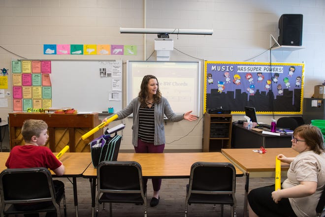 Music teacher Erin McFarland instructs special education students how to play with the Boomwhackers during class at McGovern Middle School in Sioux Falls, S.D., Monday, March 4, 2019.
