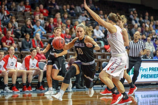 USF's Jessie Geer drives the lane in Monday's NSIC tournament semifinal