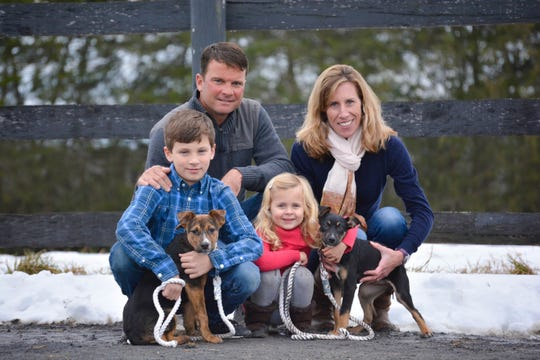 Jason and Alisa Berry with children Carter and Sydney, and their pet dogs.