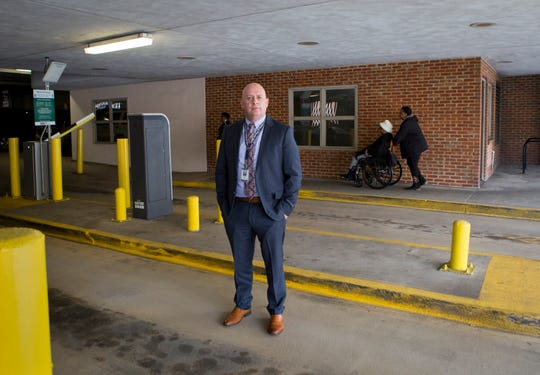 Charlottesville, Virginia, police Detective Declan Hickey stands in the parking garage where six men beat DeAndre Harris during the Unite the Right rally in 2017.