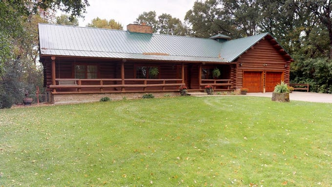 The home offers the beauty and comfort of a real log cabin.