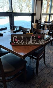 A hand-painted sign used to mark the Gals That Brunch table at Granity City Food & Brewery in St. Cloud Sunday, March 3.