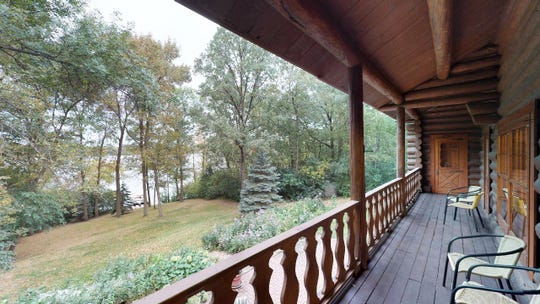 A tranquil covered back deck runs the length of the entire kitchen and dining area.