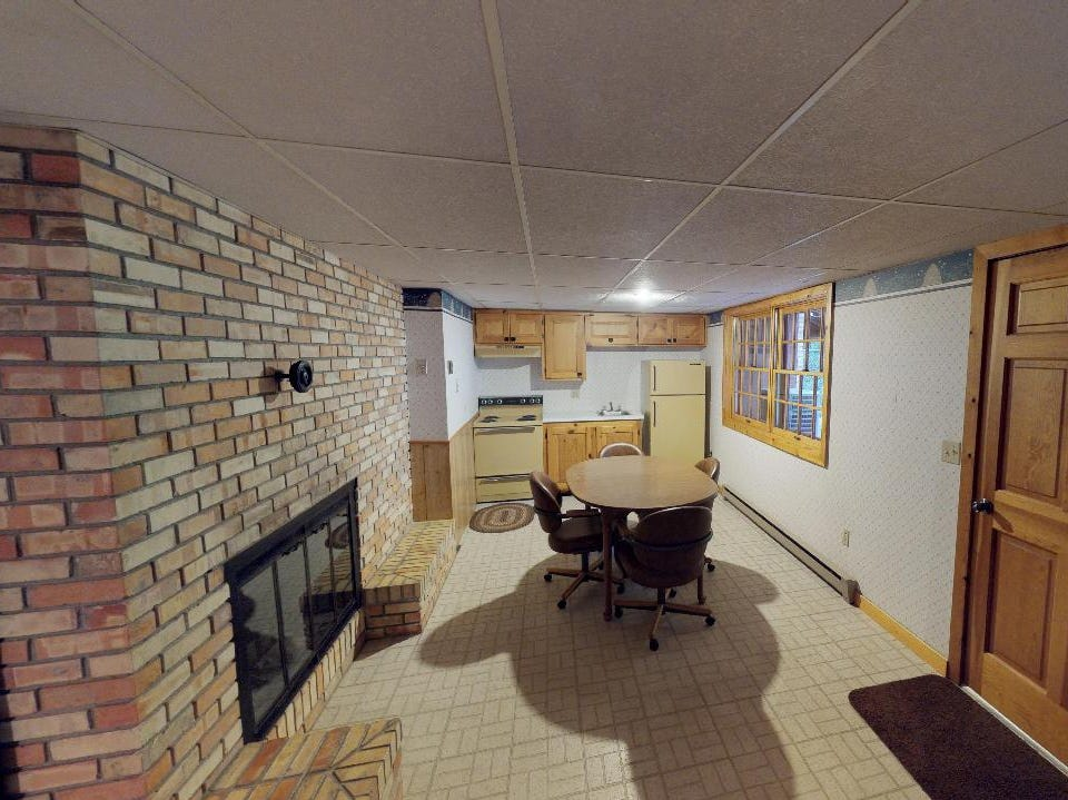 The highlight of the lower level is the mother-in-law suite, which has its own separate entrance and walkout, kitchen, bathroom and brick wall fireplace.