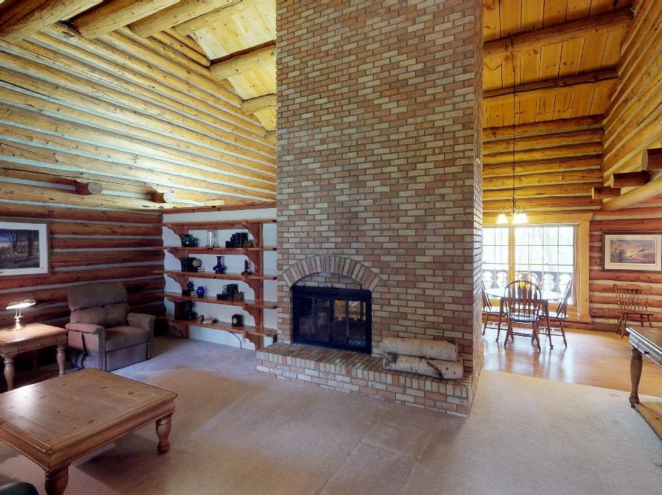 The two-sided fireplace warms both the huge great room and the kitchen.