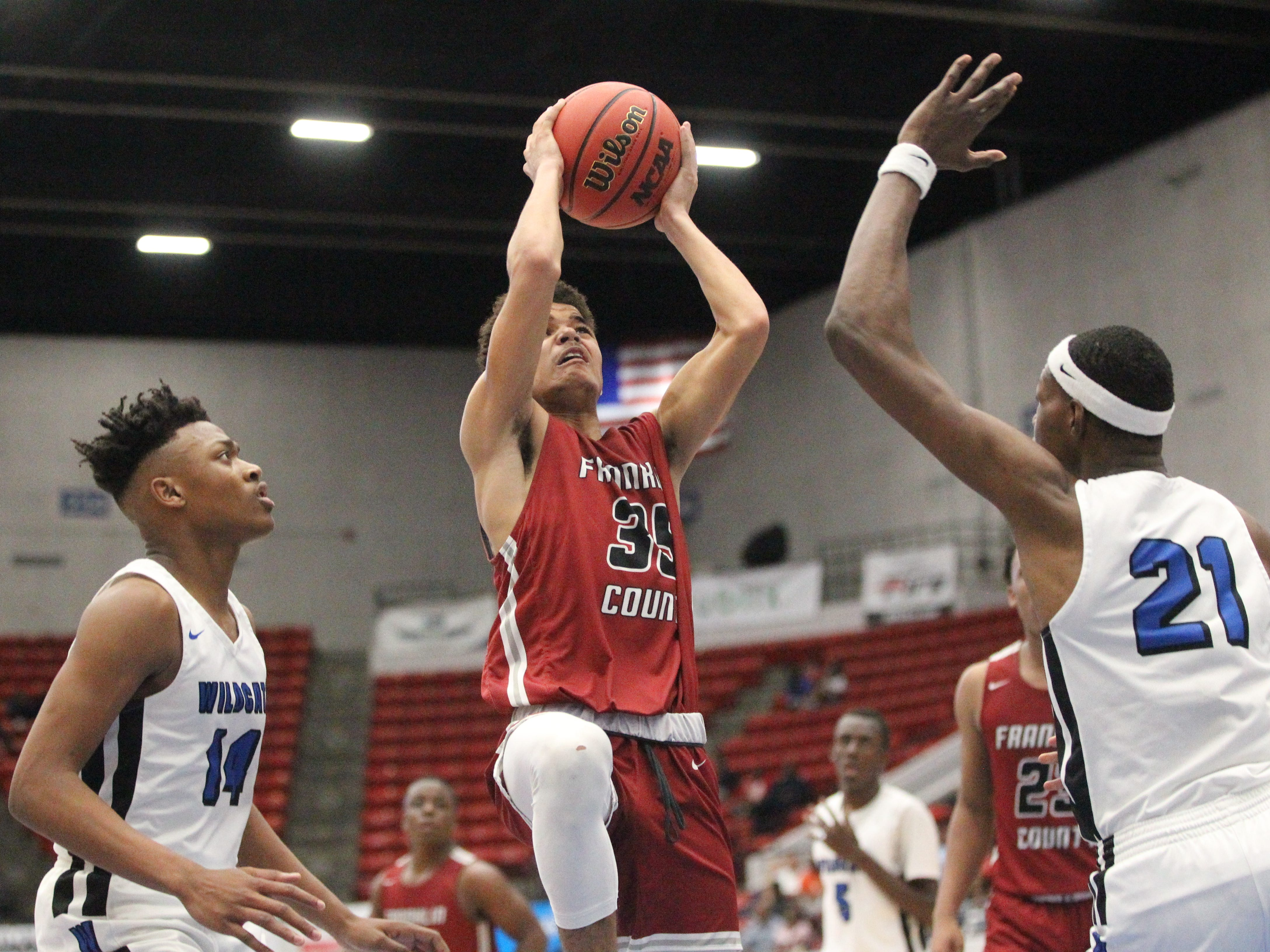 Franklin County sophomore Lamarius Martin hangs in the air for a basket as the Seahawks lost 76-62 to Wildwood during a Class 1A state semifinal at the RP Funding Center in Lakeland on March 4, 2019.