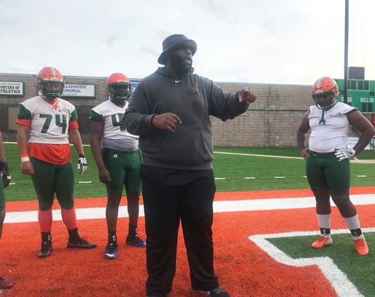 FAMU offensive line coach Alex Jackson explains blocking strategies during the first day of spring practice on Sunday, March 3, 2019.