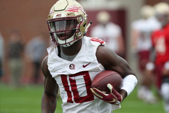 Anthony Grant (10) runs a route during Florida State University football's first spring practice Monday, March 4, 2019.