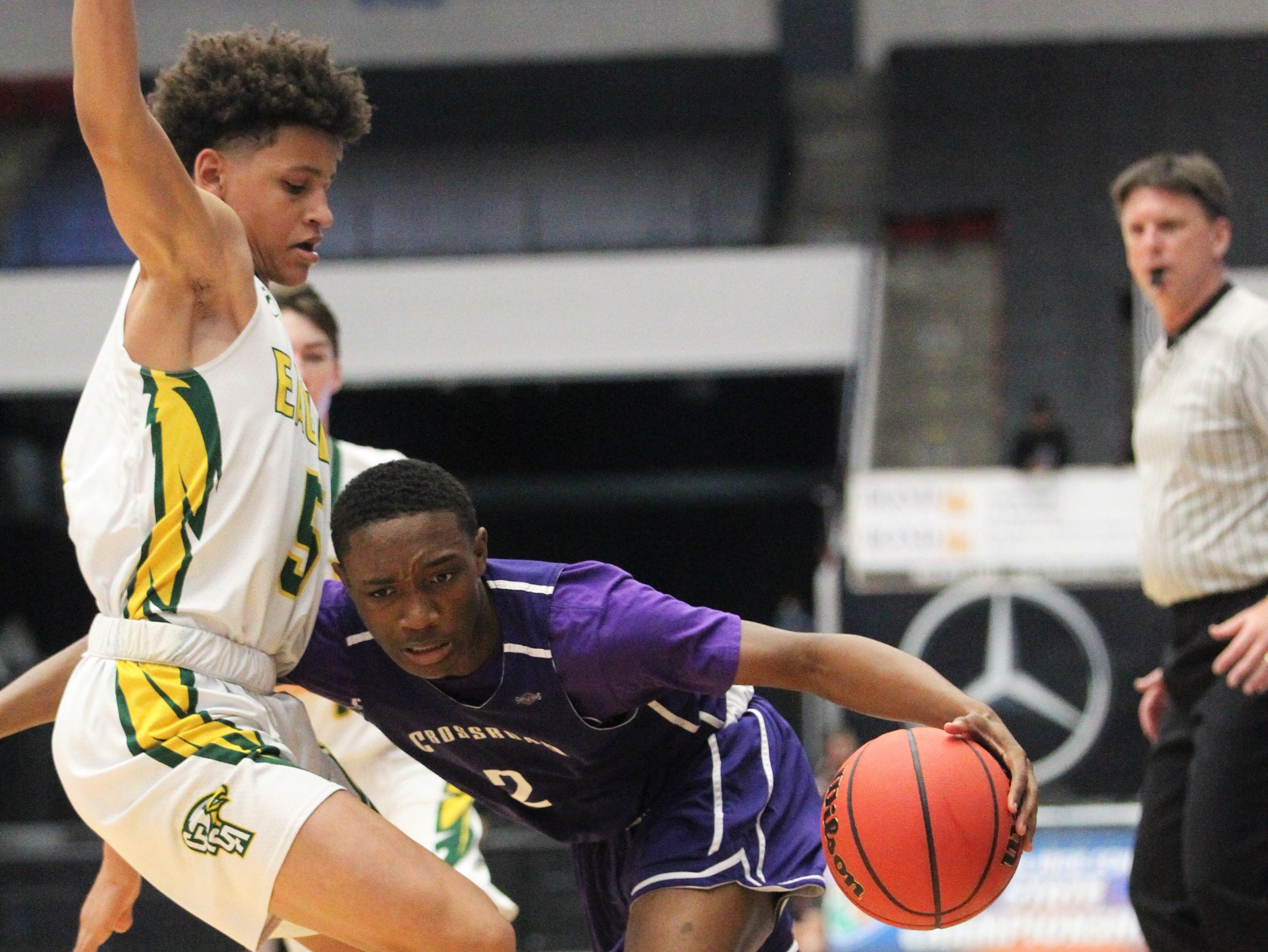 Crossroad Academy guard Jeremiah Outley tries to get past a defender as the Scorpions played Central Florida Christian Academy during a Class 2A state semifinal at the RP Funding Center in Lakeland on March 4, 2019.