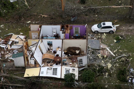 Seen from the air, parts of Cairo, Ga. are heavily damaged Monday, March 4, 2019 after a tornado ripped through the town Sunday night.