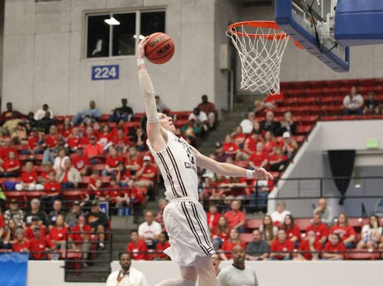 Madison County senior forward Dilan Lawson goes up for a dunk attempt as the Cowboys beat Paxton 63-51 during a Class 1A state semifinal game at the RP Funding Center in Lakeland on March 4, 2019.