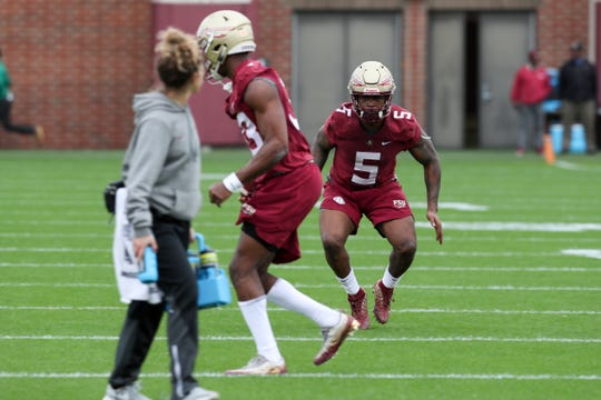 Linebacker Dontavious Jackson (5) runs a drill during Florida State University football's first spring practice Monday, March 4, 2019.