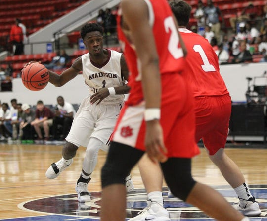 Madison County senior guard Vincenta Mitchell drives into the paint as the Cowboys beat Paxton 63-51 during a Class 1A state semifinal at the RP Funding Center in Lakeland on March 4, 2019.