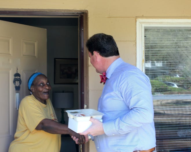 Mayor John Dailey delivers a meal during the Big Wheels Deliver Meals event on Feb. 25.