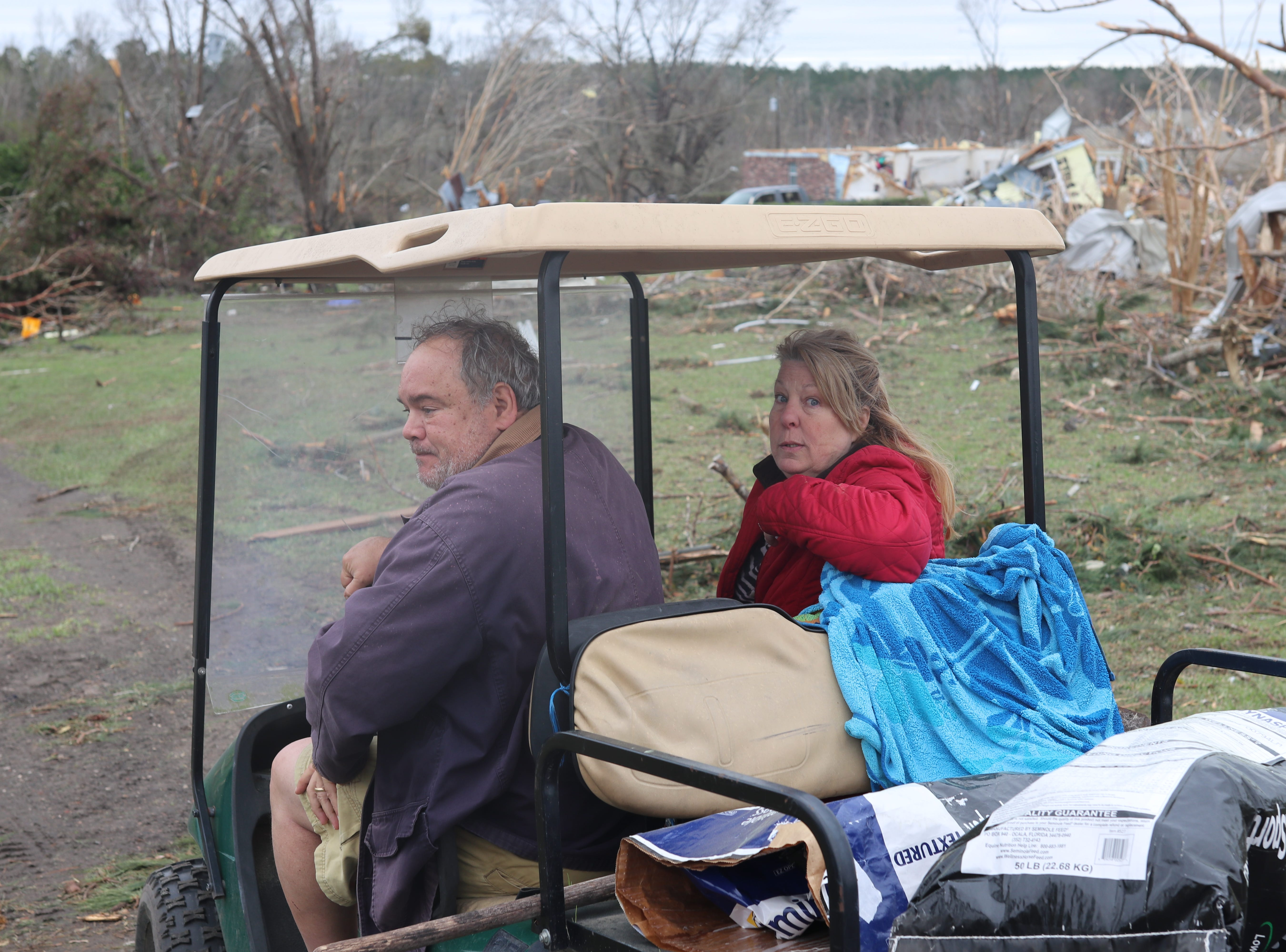 Doug and Angie Barkley check on their neighbors in the Baum Community following a tornado Sunday March 3.