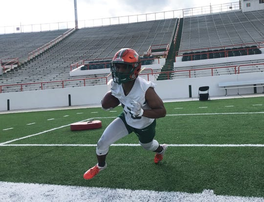 FAMU running back Bishop Bonnett bounces outside during a drill at spring practice on Sunday, March 3, 2019.
