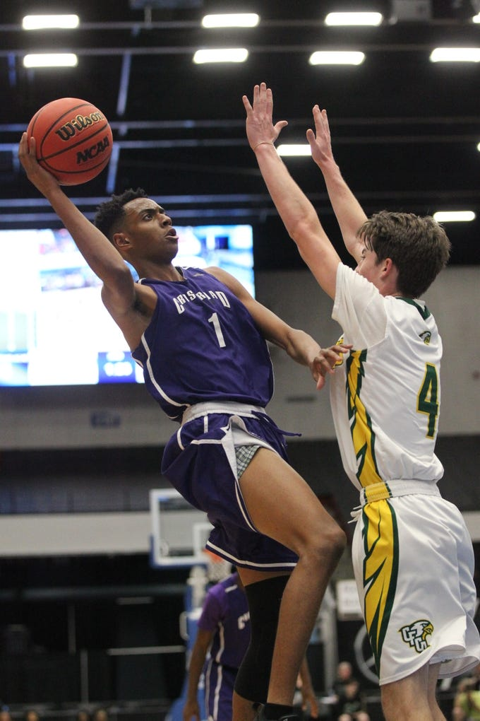 Crossroad Academy guard Paul Mathews goes up for a layup as the Scorpions fell to Central Florida Christian Academy during a Class 2A state semifinal at the RP Funding Center in Lakeland on March 4, 2019.
