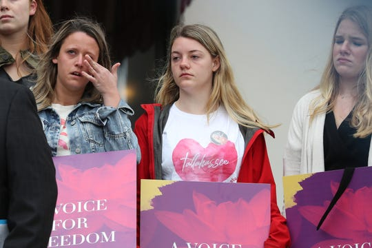 Friends of Maura Binkley get emotional as they remember their friend during a gathering at the Florida Historic Capitol to celebrate the launch of Maura's Voice, a foundation created to research and understand the relationship between mental illness, hate and violence Monday, March 4, 2019.