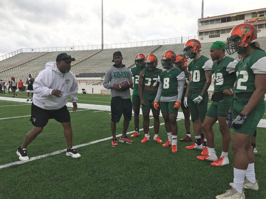 FAMU Hall of Famer Billy Rolle pumps up the defensive backs during the first day of spring practice on Sunday, March 3, 2019.