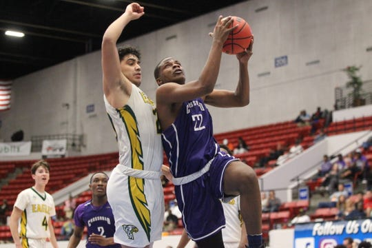 Crossroad Academy forward Dedric Streeter drives for a layup as the Scorpions fell 59-44 to Central Florida Christian during a Class 2A state semifinal at the RP Funding Center in Lakeland on March 4, 2019.